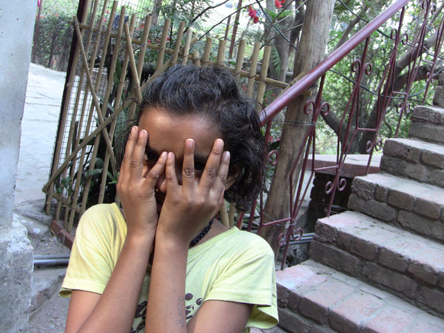 girl-at-Ramanas-Garden-hiding