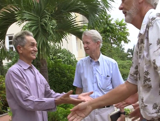 Chuck Searcy founder of Project Renew in in Frienship Village outside Hanoi, Vienamese veteran shaking hands with US veteran (still)